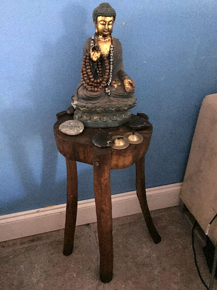 Rustic wood buddha stand